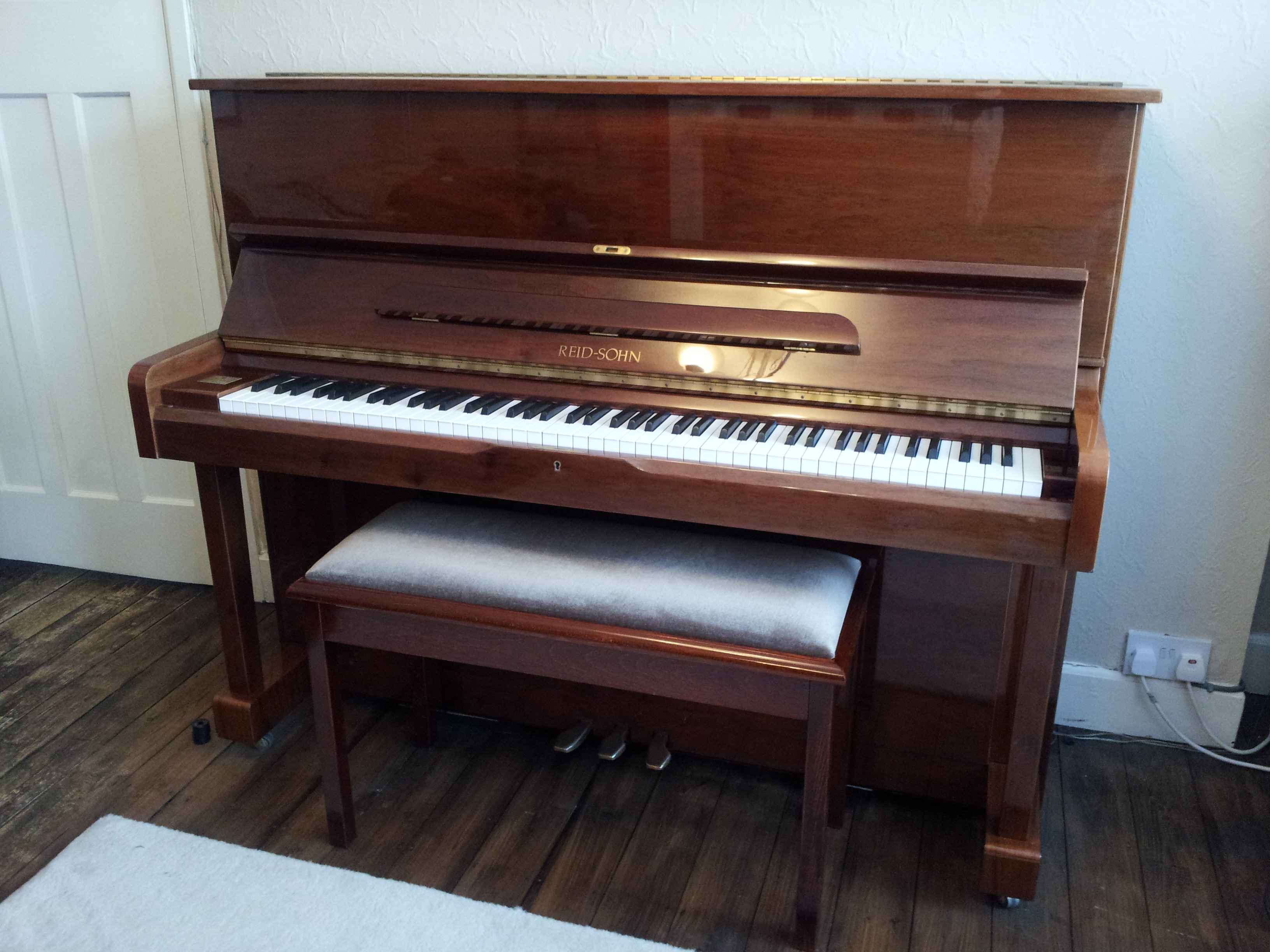Reid Sohn upright piano with piano stool
